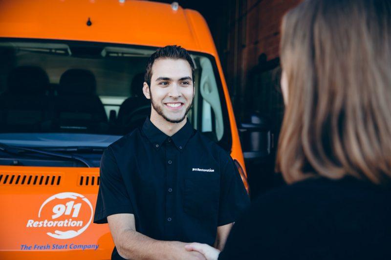 commercial restoration technician talking to customer