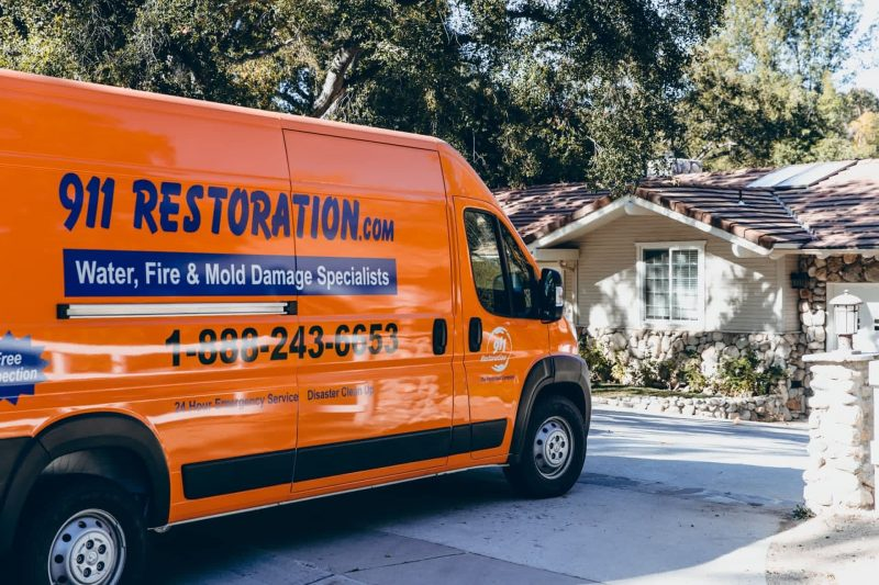 disaster restoration vehicle parked in front of house
