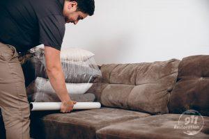 restoration technician packs up furniture